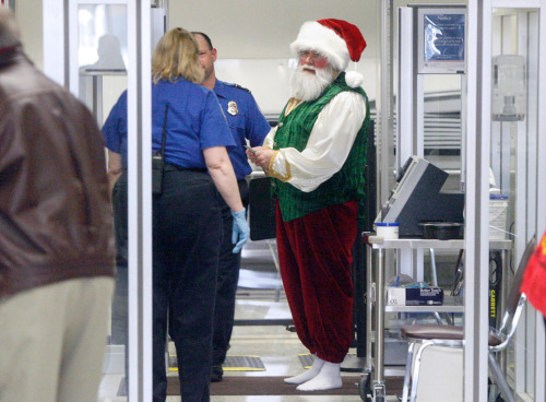 "thedailywhat:  Photo of the Day: ""Santa Claus Larry Durian is screened by TSA agents before entering a secure area of the Akron Canton Airport Wednesday, Dec. 8, 2010 in Green, Ohio. Santa planned to spend seven hours at the airpo"