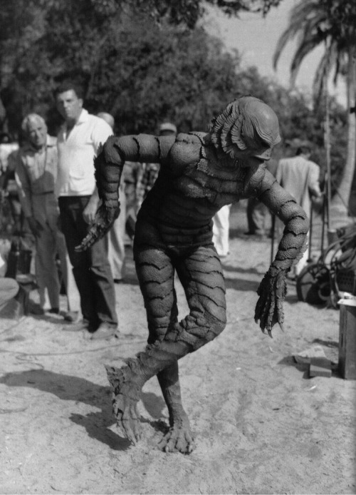 "Ben Chapman relaxes between takes on the set of Creature from the Black Lagoon (1954, dir. Jack Arnold) (via Hollywood Horror: Gothic to Cosmic) ""The reason they didn't credit me in the movie, and this is crazy, is  the studio wanted to give the impression, the illusion, that it was a  real creature. If you see the original Frankenstein, Boris  [Karloff] doesn't get credit. It's a question mark in the credit. I  looked at the studio and asked if they thought the people were that  stupid, and they said, 'You'd be surprised what people believe'"""