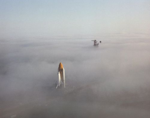 ibeching:  Space Shuttle Challenger moving through fog in 1986.