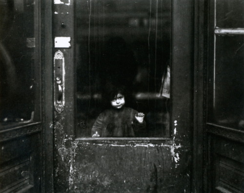 liquidnight:  Lewis W. Hine Child in a Doorway, circa 1910s From Kids at Work: Lewis Hine and the Crusade Against Child Labor