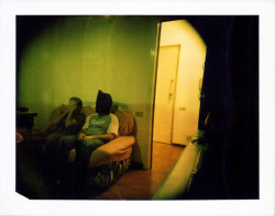 Watching TV  Polaroid Camera: HOLGA + Polaroid BackFilm: 125i Studio Single SILKExpired: 03/2008 Format: 8.5 x 10.8 cm 3 ¼ x 4 ¼ in. No Photoshop