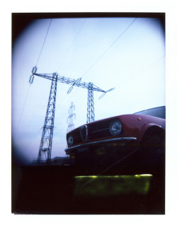 Do Supercars Still Have Soul?   PolaroidCamera: HOLGA + Polaroid BackFuji Paper 100 ISO Format: 3.25 x 4,25 in. / 8.5 x 10.8 cmAlfa Romeo Alfetta - First Series