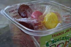 Trader Joe's Organic Lollipops. They come in five delicious flavers — watermelon, pomegranate, orange, lemon, and raspberry — and are only 70 calories per 3 pops. A delicious treat! $2.99 for a container of about 27 at Trader Joe's.