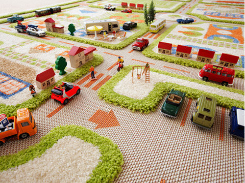 littlefrills:  Awesome Play  Rugs from Danish byDesign…wow, these have come a long way since I was a kid. They are so colorful and it even has a roundabout! They have a wide range of three-dimensional rugs, this one is my favorite…see more here. {via LMNOP}  Ben is going to need this.