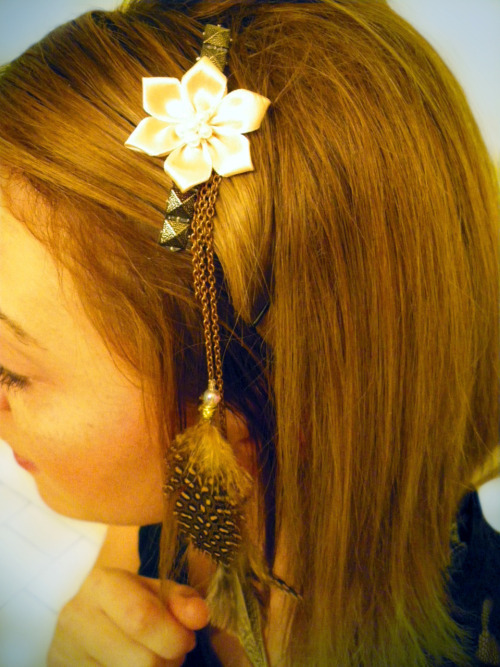 Peach flower, gold studs, and feathers on a chain that I made