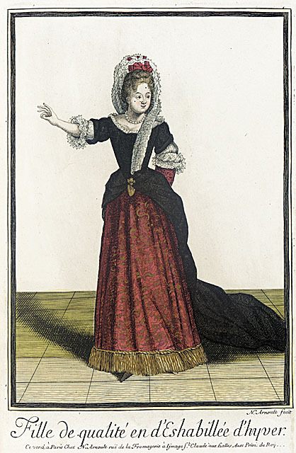 Woman's wear of the late 17th century still strictly conformed to fashion rules despite the cold weather. The court-fashion-dictated half length sleeves were not lengthened for winter. Women instead kept there lower arms in muffs, as seen on her left arm.