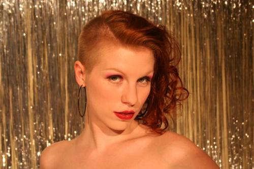 My first pinup photo, taken by Steven dePolo in 2006. I had my ladyhawk for 6 years. Since then, I've spent my hairdo time fashioning various, poodlesque versions.