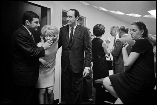 A New York City office party in 1966. Slate has a chummy photo gallery of workplace merrymaking through the years. Have fun this evening, drinking drones of the U.S.A.