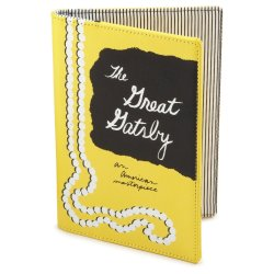 """The Great Gatsby"" Kindle Cover by Kate Spade. I actually don't own this because a.) I don't own a Kindle, and b.) it costs almost as much as a Kindle. But I covet it so bad. I want it more than the Kindle. $85 — yes, you read that right — at Amazon."