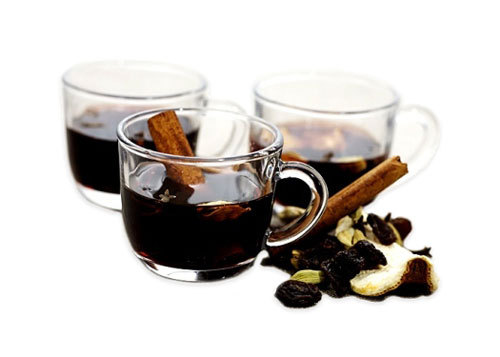 Glasses of glogg. Swedish mulled wine, hot Christmas punch with raisins, cinnamon, almonds & spices.