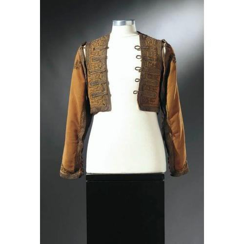 Son Of The Sheik (1926)Bolero vest with detachable sleeves worn by Rudolph Valentinoby Western Costume Company This vest is worn without the sleeves throughout much of the film and in publicity stills.