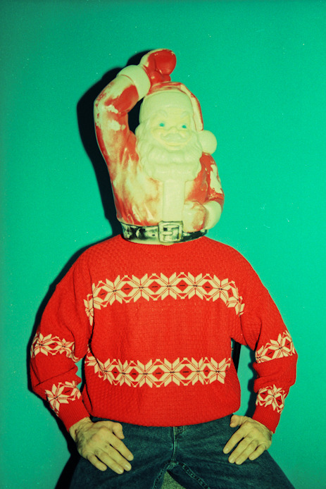 "Past Christmas Classics: RETRO SANTA ON GEOFF'S HEAD No. 01 - ""SWEATER MAKES IT BETTER"" Not really sure what to say about the next few photos I'm going to post here, except for that once I realized this vintage Santa lawn ornament could fit on my friend Geoff's head I got really excited."