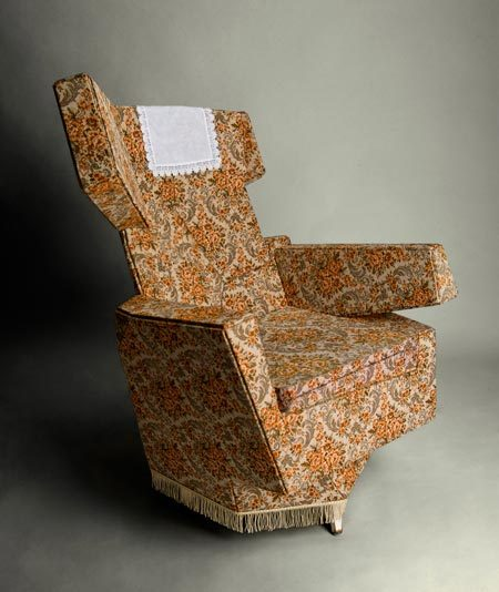 abstract modern chair with traditional upholstery by Hannes Grebin