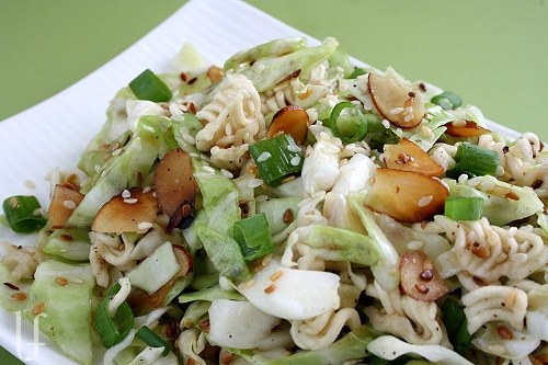 Chinese Cabbage Salad   Ingredients: 1 1/2 tablespoons butter 1/3 cup sesame seeds 1/3 cup sliced almonds 1 package ramon noodles, broken – minus the spice packet 1 small head  of cabbage, chopped or sliced fine 1 bunch green onions, sliced – green parts only 4 tablespoons Splenda 1 tablespoon freshly ground black pepper 4 tablespoons canola oil or olive oil 1 1/2 teaspoons salt – or to taste 7 tablespoons rice wine vinegar – original Method: 1) In a frying pan, over medium heat, melt the butter; saute the sesame seeds, almonds, and broken ramen noodles until golden brown.  Set aside to cool completely. 2) In a large bowl combine the cabbage and green onions.  In a blender or food processor emulsify the Splenda, pepper, oil, salt, and rice wine vinegar until creamy.   3) Pour over the cabbage and toss.  Add the sesame mixture and toss.  Add more salt to taste, if necessary.  Serve immediately. This recipe makes 10 servings with 97 calories each.