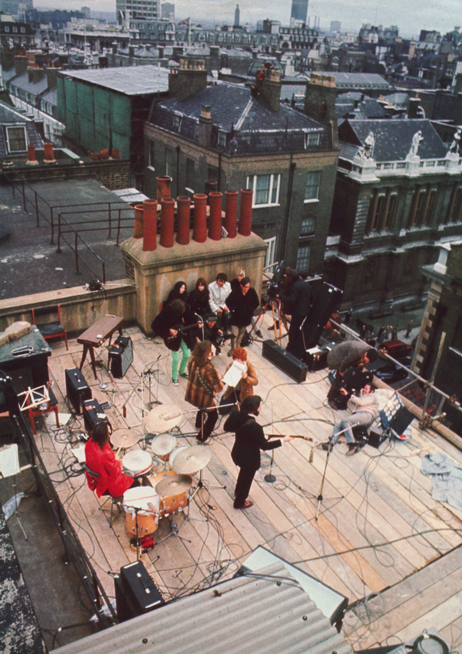 awkward-y0uth:  sun—dazed:  g-rayson:   The Beatles, on the rooftop of Apple Headquarters. For the recording of the film Let It Be, their last live concert as a band.  oh this explains why at the end of Across the Universe they sing those two songs on the top of a roof.  i loooooove that movie  dont let me ddoooooown