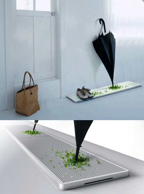 katykelley:szymon:   Green umbrella stand from Junjie Zhang  It grows grass from the water dripping off your umbrella.  GENIUS!
