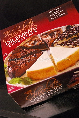"Trader Joe's Chocolate Dilemma Cheesecake. The cheesecake that made me go, ""Hmm, maybe I do like cheesecake, after all."" One box has four delicious flavors — plain, tuxedo, chocolate chip and triple chocolate. About $7 (can't remember the exact price right now) at Trader Joe's."