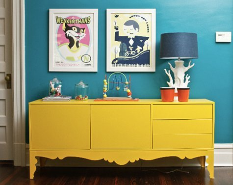 A good dose of happy colors!  A yellow credenza against a turquoise wall!  Loving the bold-ness!