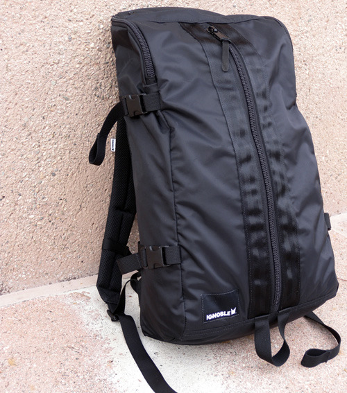 IGNOBLE / MONA COCOON BACKPACK Ignoble is a small startup launched last year by brothers Dan and Doug Hinds. The duo shares a lot more than a last name.  They are both passionate about making things simple and functional, and are both slightly obsessed with the color black! Dan and Doug drew on their past experience in soft goods design and manufacturing to create Ignoble's first backpack, the Mona. Manufactured in the US and hand-assembled in small runs, the Mona is a backpack for connoisseurs. The backpack is constructed using ultra-tough nylon materials and heavy-duty zippers.  It has a very unique shape that maximizes holding capacity and makes access to the various internal compartments very convenient.  And its simple, jet-black design gives it a sleek, modern look.  Here are some close-up photos for a better look.    To learn more about Ignoble and its Mona Cocoon Backpack, visit the company's website. $219