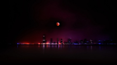 The 2010 Winter Solstice Lunar Eclipse over Jersey City, NJ (by Steve Kelley)   © 2010 Steve Kelley