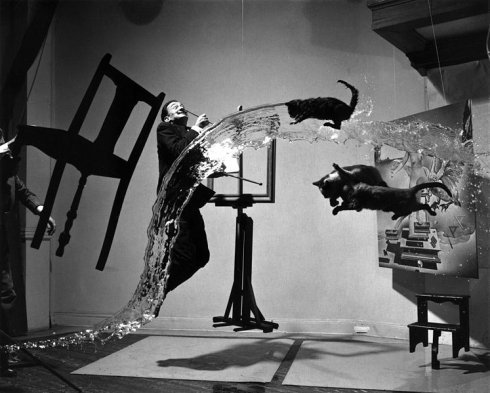 "Philippe Halsman's 1948 work ""Dali Atomicus"" explores the idea of suspension, depicting three cats flying, a bucket of thrown water, and Salvador Dalí in mid air."