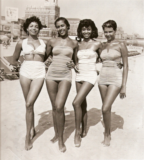crustyriotqueer:  [img: four black women in 1950's style bathing suits standing arm-in-arm on the beach]   So much style and awesome here. I love vintage bathing suits and these ladies are rocking the hell out of them.