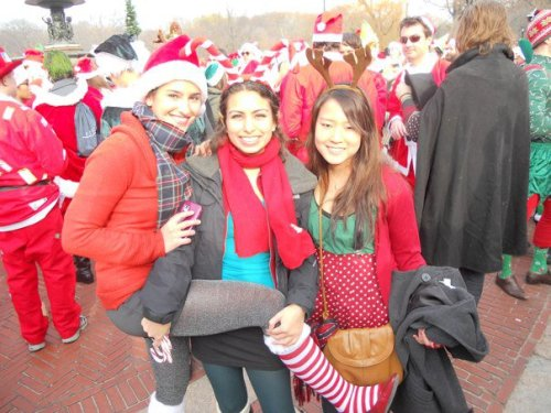 Lindsey, I and Christina at Santacon.  Girls without cares dancing around in Santa hats.