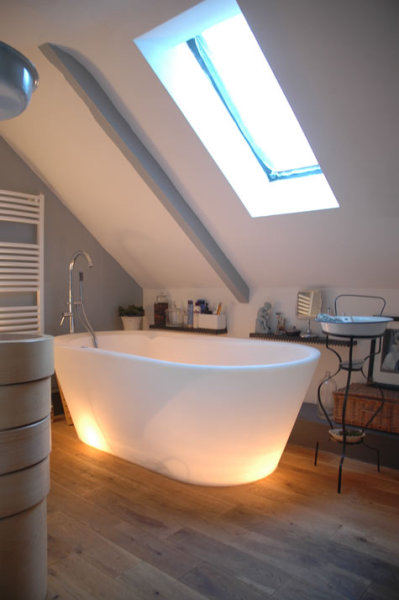 let's talk about this bathtub. lights inside, and it gets softer when you put hot water in it. crazy. [via: designsponge]