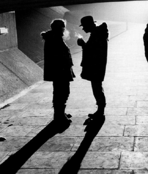 "Stanley Kubrick & Malcolm McDowell on the set of A Clockwork Orange (1971, dir. Stanley Kubrick) (via) ""Well, as you know, when Singing in the Rain came out, for generations of people, [Gene Kelly] swinging around that lamp post and slapping in that water, and singing…it's one of the most euphoric moments we've ever seen on film. So when I had to come up with something for this sequence, which involved my character in a very brutal situation, that's when he's happiest. So Singing in the Rain just popped out. I just started singing it, and [Stanley] Kubrick bought the rights and we redid the whole thing and incorporated it. A footnote to that is that a year afterward, when the film had been out and it was a big hit, I was invited to come to Hollywood by Warner Brothers. I came out and it was very nice to meet everybody. I had never been to Hollywood before. And some guy who was my minder said, 'Hey, there's a party in Beverly Hills tonight, Malcolm. Do you want to go, there's going to be lots of stars there?' And I went, 'Yeah! I would love to!' I was like a kid in a candy store. And we go and he said, 'Hey, you won't believe this. Gene Kelly's here. Would you like to meet him?' And I went, 'Oh yeah!' (laughs) So he had his back to me and he tapped him on the shoulder and said, 'Gene, I'd like to introduce you to Malcolm McDowell' and he looked at me and…then turned around and walked off. But you know, I totally got it. I totally understood. I took his glorious moment and put a different spin on it. I guess I kind of ruined his moment in a way. But of course, it was an homage to him, because it was so amazing. And so indelible in me as a person, that I blurted it out and started singing it [while filming the scene]."" -Malcolm McDowell (via)"