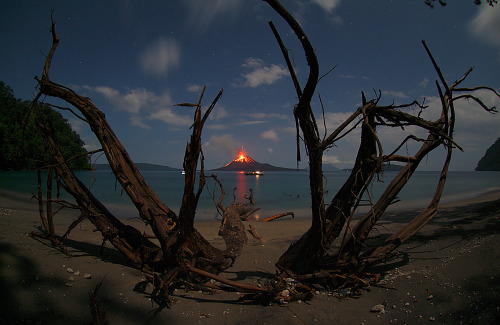 "fuckyeahvolcanoes:  Erupting Volcano Anak Krakatau. Marco Fulle. From the image's page, ""In 1927, eruptions caused … Anak Krakatau to rise from the sea, and the emerging volcanic island continues to grow at an average rate of 2 cm per day."""