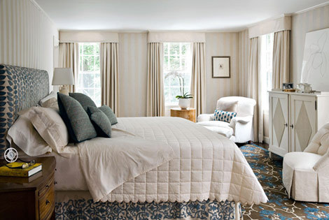 Ivory bedding against a gorgeous a blue printed upholstered bed, and fantastic blue, cream, and navy rug! Dreamy.  Love the layers.