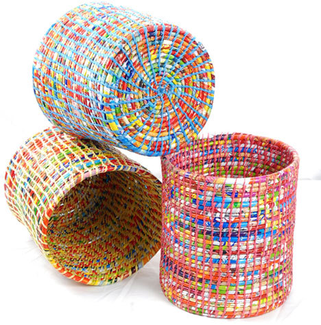 These Wastepaper Baskets are made from cast-off plastic wrappers (and presumably plastic bags) by artisans in Nepal. The $36 bags are manufactured under the SPIRAL Foundation Workshop, a nonprofit that renders asisstance to developing countries, and proceeds help keep a health clinic in Nepal up and running.   Spiral Foundatin's Wastepaper Baskets made from waste - Core77