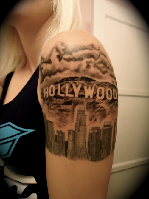 I added the Los Angeles skyline to my arm to give myself a permanent memory of Summer 2010. A month later I added the Hollywood sign above it. Without a doubt, it has been the roughest Summer of my life, and Los Angeles/Hollywood was my escape away from it all. LA has and always will be my favorite city, and when ever things got heavy I'd always go for drives through downtown, the canyons, and the Hollywood sign. It helped me escape my problems for a little bit and just enjoy the beautiful scenery. So I thought it only made sense to get such a memorable moment in my life put on my arm forever, where I can always look down and remember that I got through the roughest Summer yet.