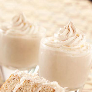 Banana Nog Recipe 11 Servings / Prep: 20 min. + chilling Ingredients: 3 cups milk, divided 3 cups half-and-half cream, divided 3 egg yolks 3/4 cup sugar 1/2 cup light rum 3 large ripe bananas 1/3 cup creme de cacao 1-1/2 teaspoons Spice Island Pure Vanilla Extract Whipped cream and baking cocoa, optional Directions: In a large heavy saucepan, combine 1-1/2 cups milk, 1-1/2 cups cream, egg yolks and sugar. Cook and stir over medium-low heat until mixture reaches 160 degrees F and is thick enough to coat the back of a metal spoon. Place bananas in a food processor; cover and process until blended. Pour milk mixture into a pitcher; stir in the banana puree, rum, creme de cacao, vanilla, and remaining milk and cream. Cover and refrigerate for at least 3 hours before serving. Pour into chilled glasses. Garnish with whipped cream and sprinkle with cocoa if desired Yield: 11 servings (about 2 quarts) Nutrition Facts: 3/4 cup (calculated without garnishes) equals 282 calories, 10 g fat (6 g saturated fat), 95 mg cholesterol, 62 mg sodium, 31 g carbohydrate, 1 g fiber, 5 g protein.