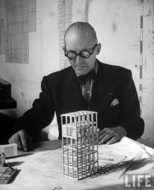 "Le Corbusier taught at his old school in La-Chaux-de-Fonds during World War I, not returning to Paris until the war was over. During these four years in Switzerland, he worked on theoretical architectural studies using modern techniques.[3] Among these was his project for the ""Dom-ino"" House (1914–1915). This model proposed an open floor plan consisting of concrete slabs supported by a minimal number of thin, reinforced concrete columns around the edges, with a stairway providing access to each level on one side of the floor plan. This design became the foundation for most of his architecture for the next ten years. Soon he would begin his own architectural practice with his cousin, Pierre Jeanneret (1896–1967), a partnership that would last until 1940."