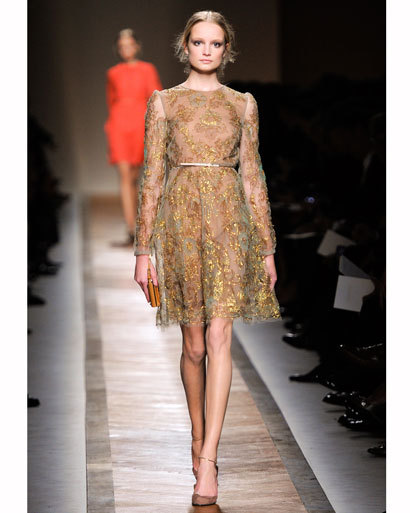 Lace was the fabric of choice for designers anticipating springtime  romance. Give muscle to a dainty dress with strong strappy heels for a  party-ready look. Get inspired for your New Years Eve party look by more of spring 2011's trends:-The Last Hurrah! Photo: Valentino spring 2011