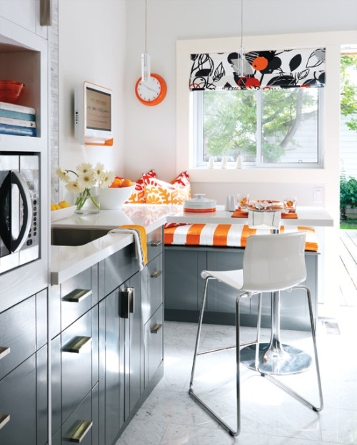 lovedesignlife:  The color orange has grown on me over the years, and it's used well in this kitchen. I've always liked the idea of adding one bright color to black and white. micasaessucasa:  5 colourful kitchens - Original orange - Kitchen - Kitchen & Bath - Style At Home