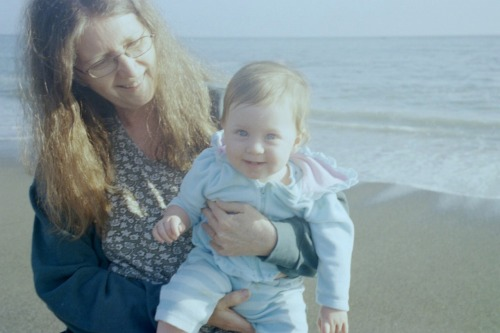 Me holding granddaughter Zoe at the beach, age 1 year.  She is two and a half now.