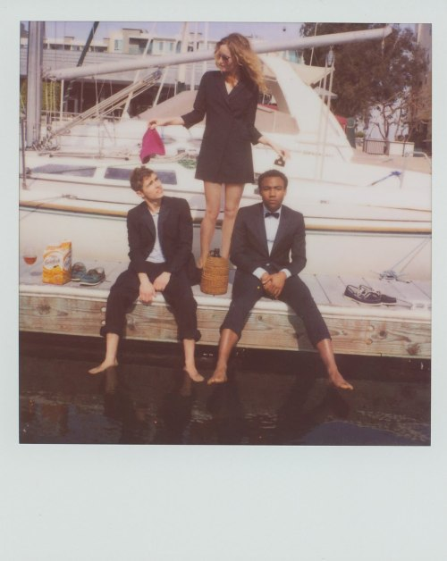 FIVE FANTASTIC PHOTOS OF 2010  1. A polaroid of Dave Franco and Donald Glover  wearing tuxedos, chilling in front of a boat, and wading their feet in the water. Leslie Mann looks on. A bow tie, some boat shoes, an afro pick and a giant box of goldfish are involved.