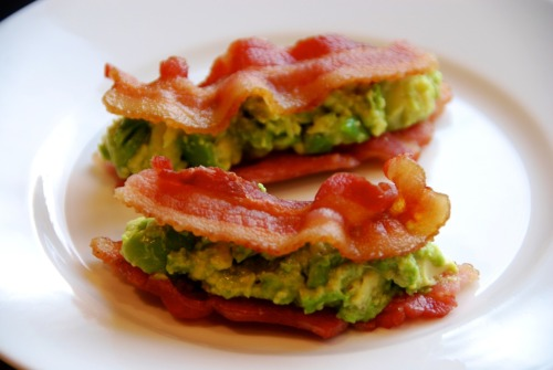 "Bacon & Guacamole Sammies Don't these bacon and guacamole sammies look good? Fitbomb noshed on them while I slept…  The ingredients: 4 strips of thick-cut pastured bacon Guacamole It's ridiculously easy to cook bacon in the microwave oven. (Clean-up is simple, too.) Just wrap a few slices between some sheets of paper towel, stick it all on a microwave-safe plate, and nuke away. I set my microwave at 70% power and zapped the bacon for about two-and-a-half minutes. If you find that your bacon's not yet crisp, just nuke it a bit longer.    The filling for these ""sandwiches""? Chunky homemade guacamole.  If you're pressed for time, simply mash up the flesh of half an avocado, and cut up the other half into half-inch cubes. Then mix both halves together in a bowl to get a nice blend of chunky 'n creamy. Flavor it with a squirt or two of lime juice and a generous pinch of Kosher salt. Done and done!"