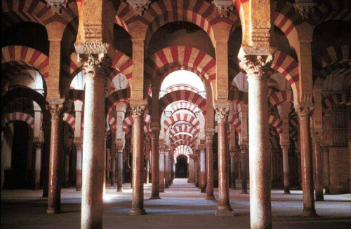 Mezquita, Cordoba This beautiful mosque was designed to give the illusion of spatial infinity. When it was functioning the interior was open to a courtyard full of trees, allowing light to spill through its 850 columns and make them appear like an extension of the trees themselves. Without any physical landmarks inside the visitor would be immersed inside what seemed a never-ending expanse of shadows and echoes.