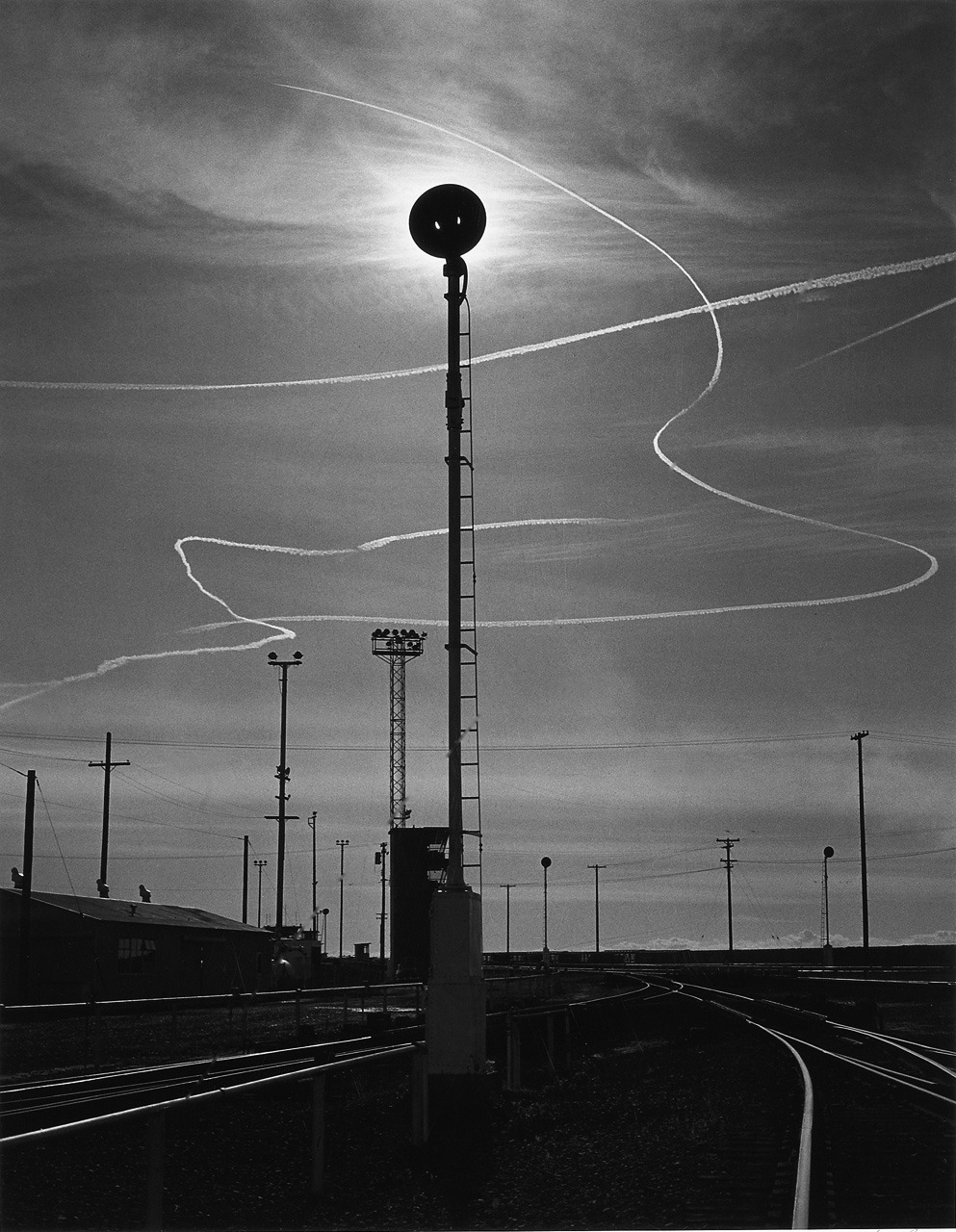 Ansel Adams, Rails and Jet Trails, Roseville, California, 1953. From melisaki.