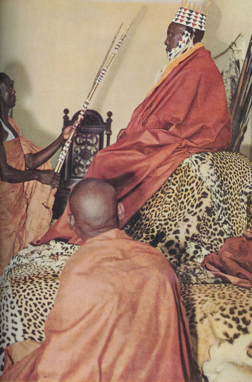 The King of Bunyaro sits on a throne of 60 leopardskins, 1960