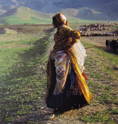 A Qashqai woman photographed by Nasrollah Kasraian during a migration to Kazerun, 1986. Qashqai women can be distinguished from women of other groups by various details of their clothing, including the way their headscarves are worn.