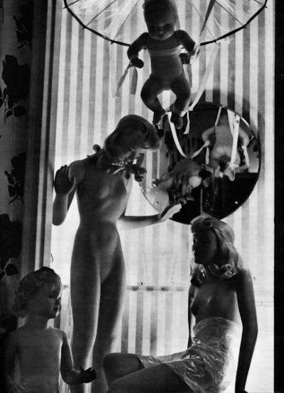 Window Mannequins by Philippe Halsman (1946) The picture, which was taken at a manufacturer's display room, was made with an Automatic Rolleiflex with a 7 1/2 cm f 3.5 Zeiss Tessar lens on Eastman Super-XX film. Halsman exposed 1/2 second a f 11. (from Popular Photography, Vol. XVIII, No.1, January 1946)