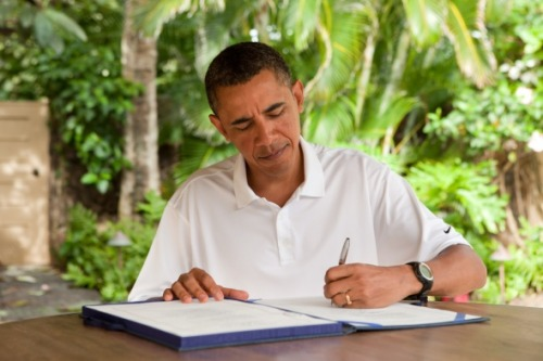 "Signed. Sealed. Delivered. President Obama signs H.R. 847, the ""James Zadroga 9/11 Health and  Compensation Act"" in Kailua, Hawaii, Jan. 2, 2011. (Official White House  Photo by Pete Souza)"