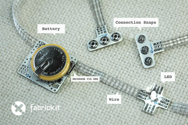 "fabrickit is a collection of wearable electronic modules, or ""bricks"", that make it easy to construct simple or complex wearable projects.Bricks connect to each other with a flexible, 3-wire conductive fabric ribbon. The fabrickit-bricks-and-ribbon approach streamlines the construction of wearable projects, making them more reliable, attractive and ready-to-wear. The fabrickit collection includes a removable, rechargeable Coin Cell Battery Brick, x-LED Brick with built-in resistor, and a Snap Connector Brick which makes connections fast and easy. via fabrick / kmackay"