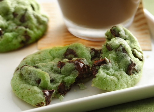 Mint Chocolate Chip Cookies Recipe INGREDIENTS: 1 pouch (1 lb 1.5 oz) Betty Crocker® sugar cookie mix1/2 cup butter or margarine, softened1/4 to 1/2 teaspoon mint extract6 to 8 drops green food color1 egg1 cup creme de menthe baking chips1 cup semisweet chocolate chunks DIRECTIONS: 1. Heat oven to 350°F. In large bowl, stir cookie mix, butter, extract, food color and egg until soft dough forms. Stir in creme de menthe baking chips and chocolate chunks. 2. Using small cookie scoop or teaspoon, drop dough 2 inches apart on ungreased cookie sheet. 3. Bake 8 to 10 minutes or until set. Cool 3 minutes; remove from cookie sheet to wire rack. Serve warm or cool completely. Store tightly covered at room temperature.
