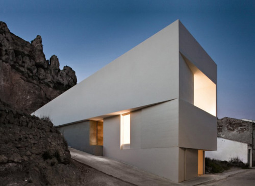 Clocking in at #2, House on Mountainside Overlooked by a Castle (Spain) by Fran Silvestre Arquitectos.