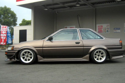 "Toyota AE86 Corolla Levin  It's occasionally whispered, in the darker recesses of the internet, that the design of the 4A-GE engine, made famous in the AE86, is based on the design of the Ford Escort BDA engine from the late 70s rally cars.  It's occasionally shouted, in all caps, in some of the darker recesses of the internet, that the RS-8 alloy wheel, made by the RS-Watanabe company of Japan, are the best looking ""retro"" 8-spoke wheel known to man.  I'm somewhat inclined to believe the former is mostly accurate, but about the later there can be no argument.  /I found the pic in this thread on retro-rides, but it's actually from the RS-Watanabe site.  PS: Bonus brown Hachi at Speedhunters."